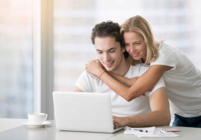 Young happy couple with laptop